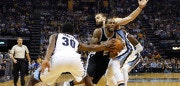 MEMPHIS, TN - APRIL 27:  Kawhi Leonard #2 of the San Antonio Spurs drives between Troy Daniels #30 and Marc Gasol #33 of the Memphis Grizzlies during the second half of a 103-96 Spurs victory in Game 6 of the Western Conference Quarterfinals during the 2017 NBA Playoffs at FedExForum on April 27, 2017 in Memphis, Tennessee. NOTE TO USER: User expressly acknowledges and agrees that, by downloading and or using this photograph, User is consenting to the terms and conditions of the Getty Images License Agreement.  (Photo by Frederick Breedon/Getty Images)