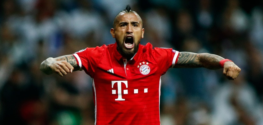 Bayern Munich's Chilean midfielder Arturo Vidal celebrates an own goal by Real Madrid during the UEFA Champions League quarter-final second leg football match Real Madrid vs FC Bayern Munich at the Santiago Bernabeu stadium in Madrid in Madrid on April 18, 2017. / AFP PHOTO / OSCAR DEL POZO        (Photo credit should read OSCAR DEL POZO/AFP/Getty Images)