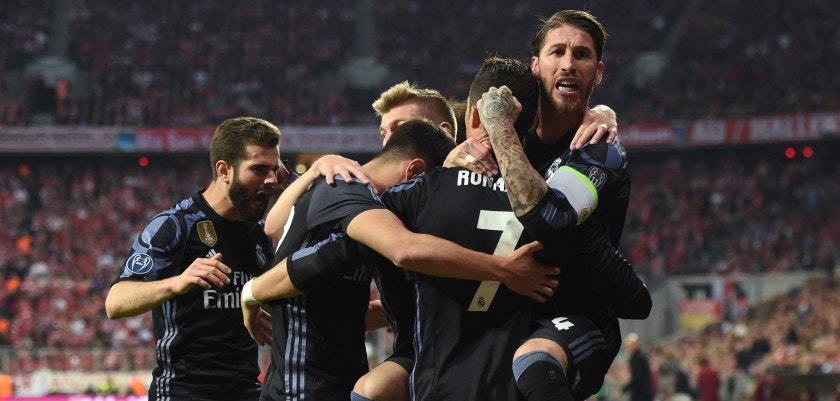 Real Madrid' players celebrate after the second goal by Real Madrid's Portuguese forward Cristiano Ronaldo (7) during the UEFA Champions League 1st leg quarter-final football match FC Bayern Munich v Real Madrid in Munich, southen Germany on April 12, 2017. Security was ratcheted up in Munich, one day after three explosions rocked the team bus of German football club Borussia Dortmund minutes after the bus set off to a planned Champions League game against Monaco on Tuesday night (April 11, 2017). / AFP PHOTO / Christof STACHE        (Photo credit should read CHRISTOF STACHE/AFP/Getty Images)