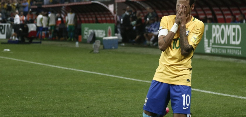 Brazil's forward Neymar celebrates after scoring against Paraguay during their 2018 FIFA World Cup qualifier football match in Sao Paulo, Brazil on March 28, 2017. / AFP PHOTO / Miguel SCHINCARIOL        (Photo credit should read MIGUEL SCHINCARIOL/AFP/Getty Images)