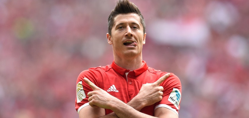 Bayern Munich's Polish striker Robert Lewandowski celebrates after scoring the 1-0 during the German first division Bundesliga football match between Bayern Munich and FC Augsburg in Munich, southern Germany, on April 1, 2017. / AFP PHOTO / Christof STACHE / RESTRICTIONS: DURING MATCH TIME: DFL RULES TO LIMIT THE ONLINE USAGE TO 15 PICTURES PER MATCH AND FORBID IMAGE SEQUENCES TO SIMULATE VIDEO. == RESTRICTED TO EDITORIAL USE == FOR FURTHER QUERIES PLEASE CONTACT DFL DIRECTLY AT + 49 69 650050         (Photo credit should read CHRISTOF STACHE/AFP/Getty Images)