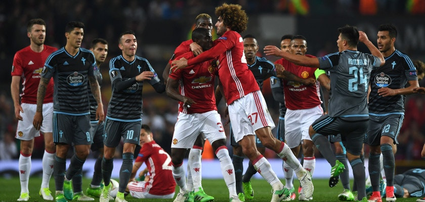 MANCHESTER, ENGLAND - MAY 11:  Players from both sides clash in the build up to Eric Bailly of Manchester United and Facundo Roncaglia of Celta Vigo being shown a red card during the UEFA Europa League, semi final second leg match, between Manchester United and Celta Vigo at Old Trafford on May 11, 2017 in Manchester, United Kingdom.  (Photo by Gareth Copley/Getty Images)