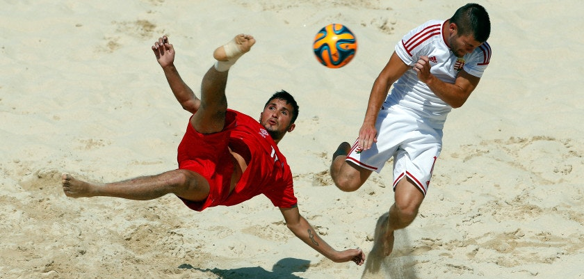 BAKU, AZERBAIJAN - JUNE 28:  Sabir Allahguliyev of Azerbaijan and Norbert Sebestyen of Hungary of compete in the Men's Beach Soccer Classification 7-8 match during day sixteen of the Baku 2015 European Games at Beach Arena on June 28, 2015 in Baku, Azerbaijan.  (Photo by Jamie Squire/Getty Images for BEGOC)