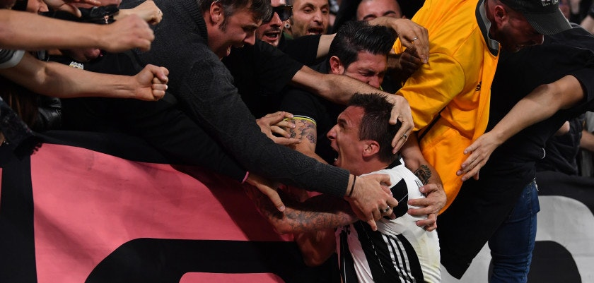 TURIN, ITALY - MAY 09:  Mario Mandzukic of Juventus celebrates with fans after scoring his goal during the UEFA Champions League Semi Final second leg match between Juventus and AS Monaco at Juventus Stadium on May 9, 2017 in Turin, Italy.  (Photo by Stuart Franklin/Getty Images)