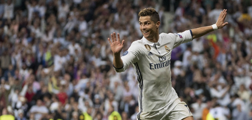 Real Madrid's Portuguese forward Cristiano Ronaldo celebrates after scoring his second goal during the UEFA Champions League semifinal first leg football match Real Madrid CF vs Club Atletico de Madrid at the Santiago Bernabeu stadium in Madrid, on May 2, 2017. / AFP PHOTO / CURTO DE LA TORRE        (Photo credit should read CURTO DE LA TORRE/AFP/Getty Images)