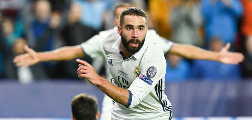 Real Madrid's Spanish defender Dani Carvajal celebrates after scoring the 3-2 goal at overtime during the UEFA Super Cup final football match between Real Madrid CF and Sevilla FC on August 9, 2016 at the Lerkendal Stadion in Trondheim. Real Madrid won 3-2. / AFP / JONATHAN NACKSTRAND        (Photo credit should read JONATHAN NACKSTRAND/AFP/Getty Images)