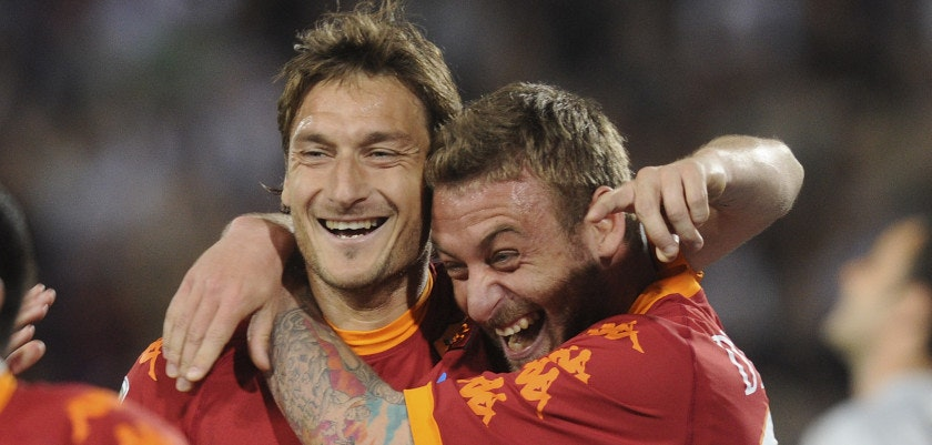 UDINE, ITALY - APRIL 09:  Francesco Totti (L) of Roma celebrates with teams mates Daniele De Rossi after scoring  his opening penalty goal  during the Serie A match between Udinese Calcio and AS Roma at Stadio Friuli on April 9, 2011 in Udine, Italy.  (Photo by Dino Panato/Getty Images)