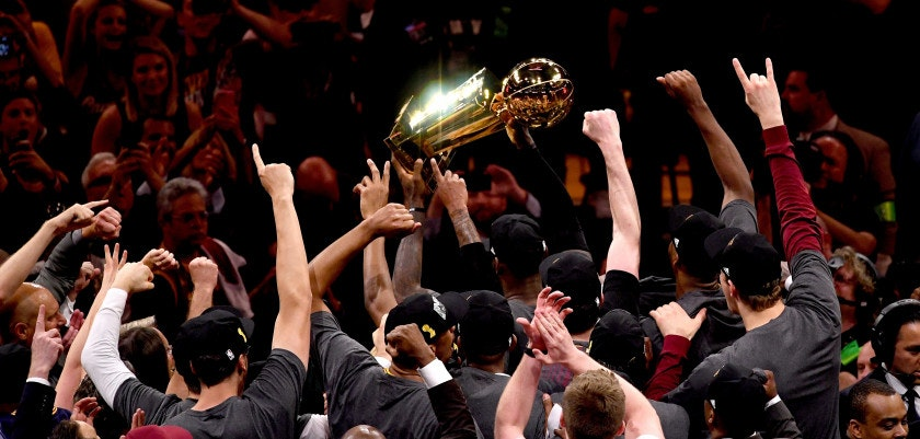 OAKLAND, CA - JUNE 19:  LeBron James #23 of the Cleveland Cavaliers holds the Larry O'Brien Championship Trophy after defeating the Golden State Warriors 93-89 in Game 7 of the 2016 NBA Finals at ORACLE Arena on June 19, 2016 in Oakland, California. NOTE TO USER: User expressly acknowledges and agrees that, by downloading and or using this photograph, User is consenting to the terms and conditions of the Getty Images License Agreement.  (Photo by Thearon W. Henderson/Getty Images)