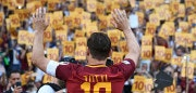 AS Roma's captain Francesco Totti greets fans during a ceremony following his last match with AS Roma after the Italian Serie A football match AS Roma vs Genoa on May 28, 2017 at the Olympic Stadium in Rome. Italian football icon Francesco Totti retired from Serie A after 25 seasons with Roma, in the process joining a select group of 'one-club' players. / AFP PHOTO / Vincenzo PINTO        (Photo credit should read VINCENZO PINTO/AFP/Getty Images)