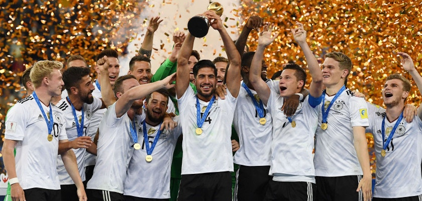 Germany's midfielder Emre Can lifts the trophy after winning the 2017 Confederations Cup final football match between Chile and Germany at the Saint Petersburg Stadium in Saint Petersburg on July 2, 2017. / AFP PHOTO / FRANCK FIFE        (Photo credit should read FRANCK FIFE/AFP/Getty Images)