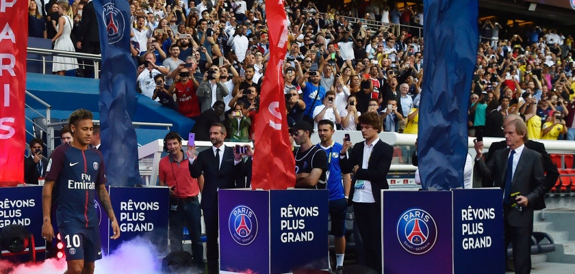 Paris Saint-Germain's Brazilian forward Neymar arrives on the pitch during his presentation to the fans at the Parc des Princes stadium in Paris on August 5, 2017.  Brazil superstar Neymar will watch from the stands as Paris Saint-Germain open their season on August 5, 2017, but the French club have already clawed back around a million euros on their world record investment. Neymar, who signed from Barcelona for a mind-boggling 222 million euros ($264 million), is presented to the PSG support prior to his new team's first game of the Ligue 1 campaign against promoted Amiens. / AFP PHOTO / ALAIN JOCARD        (Photo credit should read ALAIN JOCARD/AFP/Getty Images)