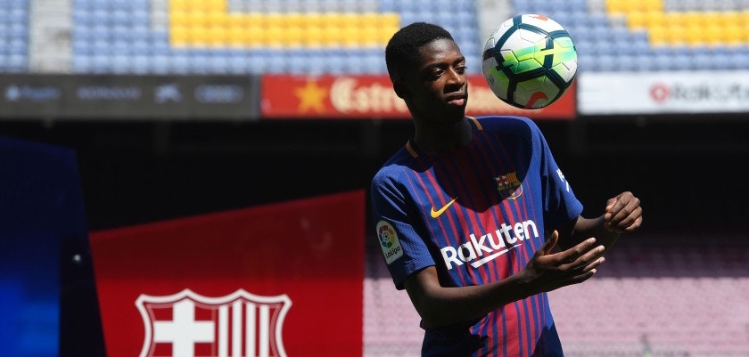 Barcelona's new player Ousmane Dembele plays with a ball as he poses at the Camp Nou stadium in Barcelona, during his official presentation by the Catalan football club, on August 28, 2017. French starlet Ousmane Dembele agreed a five-year deal with Barcelona worth 105 million euros ($125 million) plus add-ons. Dembele, 20, moves from Borussia Dortmund, where he has been suspended since he boycotted training on August 10 in protest after the German club rejected Barca's first bid.  / AFP PHOTO / LLUIS GENE        (Photo credit should read LLUIS GENE/AFP/Getty Images)