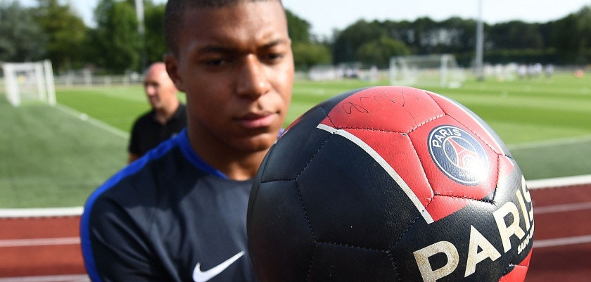 France's forward Kylian Mbappe signs autographs before a training session in Clairefontaine en Yvelines on August 28, 2017, as part of the team's preparation for the FIFA World Cup 2018 qualifying football match against The Netherlands and Luxembourg. / AFP PHOTO / FRANCK FIFE        (Photo credit should read FRANCK FIFE/AFP/Getty Images)