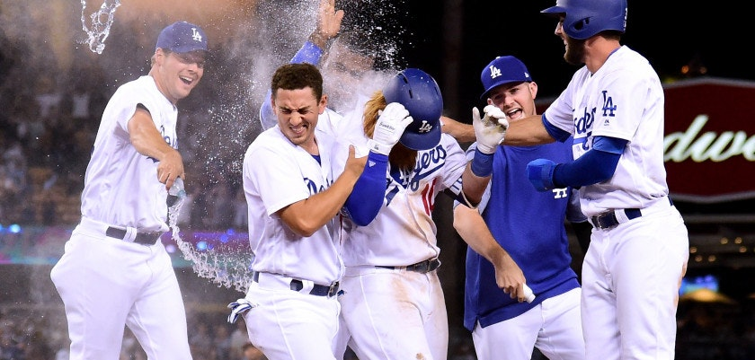 LOS ANGELES, CA - JULY 26:  Justin Turner #10 of the Los Angeles Dodger celebrates his game winning single to score a run with Rich Hill #44, Austin Barnes #15, Alex Wood #57 and Chris Taylor #3 for a 6-5 win over the Minnesota Twins, during the ninth inning at Dodger Stadium on July 26, 2017 in Los Angeles, California.  (Photo by Harry How/Getty Images)