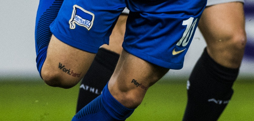 "Berlin's Slovakian midfielder Ondrej Duda sports tattoos over his knees reading ""work hard, play hard"" during the UEFA Europa League group J football match Hertha Berlin v Athletic Bilbao in Berlin on September 14, 2017.  / AFP PHOTO / John MACDOUGALL        (Photo credit should read JOHN MACDOUGALL/AFP/Getty Images)"