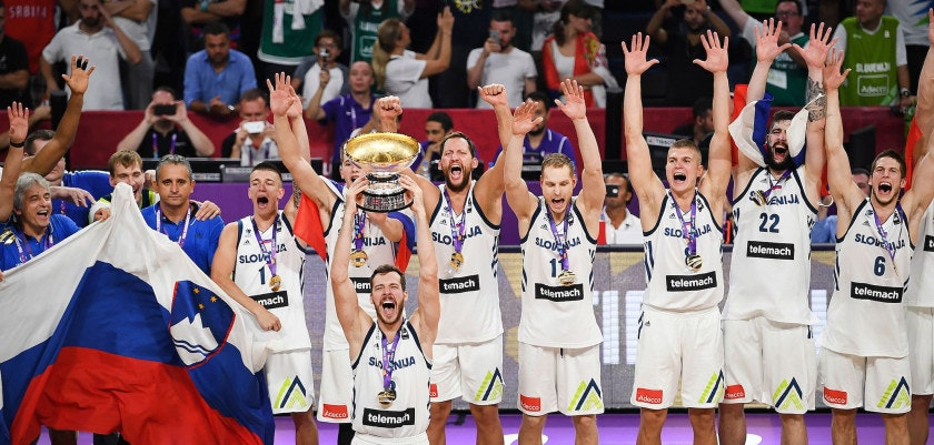 Slovenia's players celebrate with their trophy after defeating Serbia at the end of the FIBA Eurobasket 2017 men's Final basketball match between Slovenia and Serbia at Sinan Erdem Sport Arena in Istanbul on September 17, 2017. / AFP PHOTO / BULENT KILIC        (Photo credit should read BULENT KILIC/AFP/Getty Images)