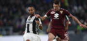 Juventus defender Medhi Benatia (L) vies with Torino's forward Andrea Belotti during the Italian Serie A football match Juventus vs Torino FC at the Juventus stadium in Turin on May 6, 2017. / AFP PHOTO / FILIPPO MONTEFORTE        (Photo credit should read FILIPPO MONTEFORTE/AFP/Getty Images)