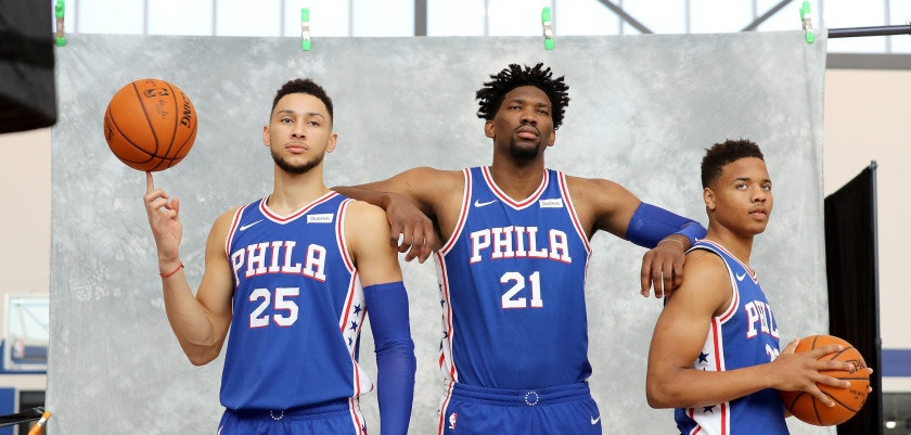 CAMDEN, NJ - SEPTEMBER 25:  Ben Simmons #25, Joel Embiid #21 and Markelle Fultz #20 of the Philadelphia 76ers pose for the camera during the Philadelphia 76ers Media Day on September 25, 2017 at the Philadelphia 76ers Training Complex in Camden, New Jersey.NOTE TO USER: User expressly acknowledges and agrees that, by downloading and/or using this photograph, user is consenting to the terms and conditions of the Getty Images License Agreement.  (Photo by Abbie Parr/Getty Images)