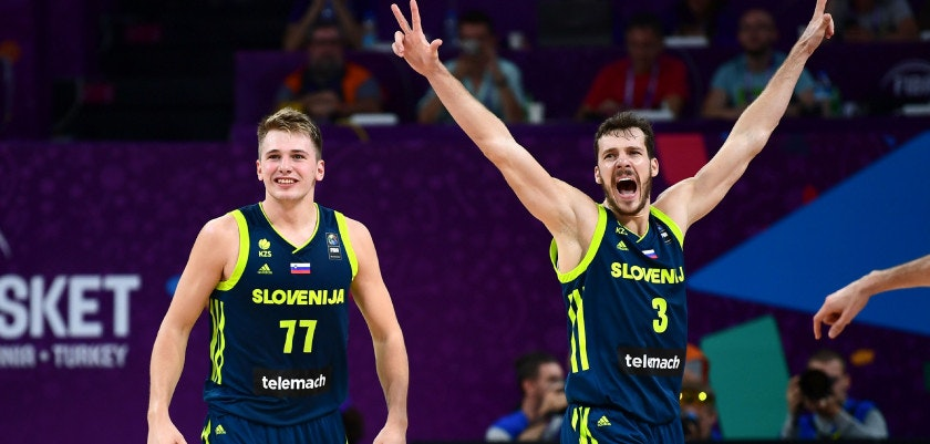 Slovenia's guard Luka Doncic (C) and Goran Dragic (R) celebrate after scoring during the FIBA Eurobasket 2017 men's semi-final basketball match between Spain and Slovenia at the Fenerbahce Ulker Sport Arena in Istanbul on September 14, 2017. / AFP PHOTO / OZAN KOSE        (Photo credit should read OZAN KOSE/AFP/Getty Images)