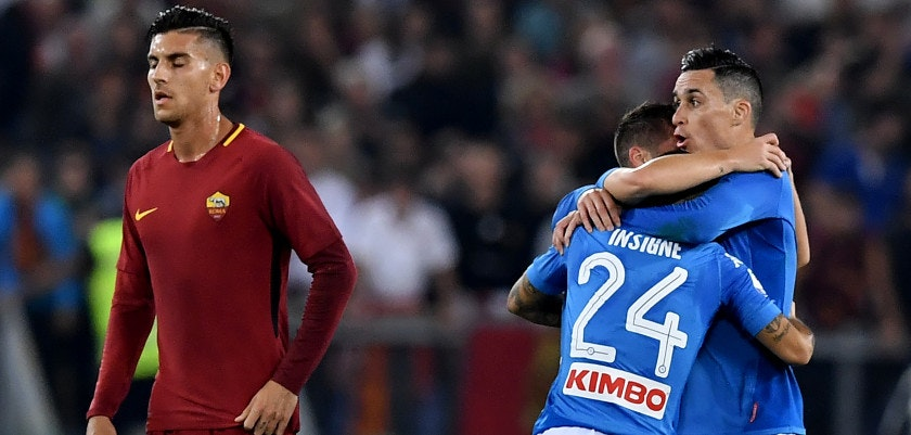 Napoli's Italian striker Lorenzo Insigne (C) celebrates with teammate Napoli's midfielder from Spain Jose Maria Callejon after scoring during the Italian Serie A football match Roma vs Napoli at the Olympic Stadium in Rome on October 14, 2017.  / AFP PHOTO / TIZIANA FABI        (Photo credit should read TIZIANA FABI/AFP/Getty Images)