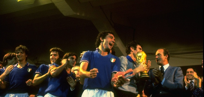 11 Jul 1982:  Dino Zoff (third right) of Italy is presented with the trophy by King Juan Carlos (right) of Spain as the rest of the Italian team celebrate after the World Cup Final match against West Germany at the Bernabeu Stadium in Madrid, Spain. Italy won the match 3-1  Mandatory Credit: Steve  Powell/Allsport
