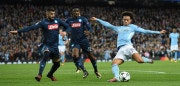 Manchester City's German midfielder Leroy Sane (R) shoots but fails to score during the UEFA Champions League Group F football match between Manchester City and Napoli at the Etihad Stadium in Manchester, north west England, on October 17, 2017. / AFP PHOTO / Oli SCARFF        (Photo credit should read OLI SCARFF/AFP/Getty Images)