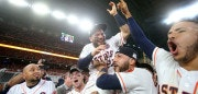 HOUSTON, TX - OCTOBER 21:  Jose Altuve #27 of the Houston Astros celebrates with Alex Bregman #2, Marwin Gonzalez #9 and Carlos Correa #1 after defeating the New York Yankees by a score of 4-0 to win Game Seven of the American League Championship Series at Minute Maid Park on October 21, 2017 in Houston, Texas. The Houston Astros advance to face the Los Angeles Dodgers in the World Series.  (Photo by Elsa/Getty Images)