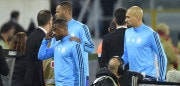 Marseille's French defender Patrice Evra (C) is escorted off the pitch by teammates Portuguese defender Rolando and Brazilian defender Doria (R) after an argument with supporters before the start of the UEFA Europa League group I football match Vitoria SC vs Marseille at the D. Afonso Henriques stadium in Guimaraes on November 2, 2017. / AFP PHOTO / MIGUEL RIOPA        (Photo credit should read MIGUEL RIOPA/AFP/Getty Images)