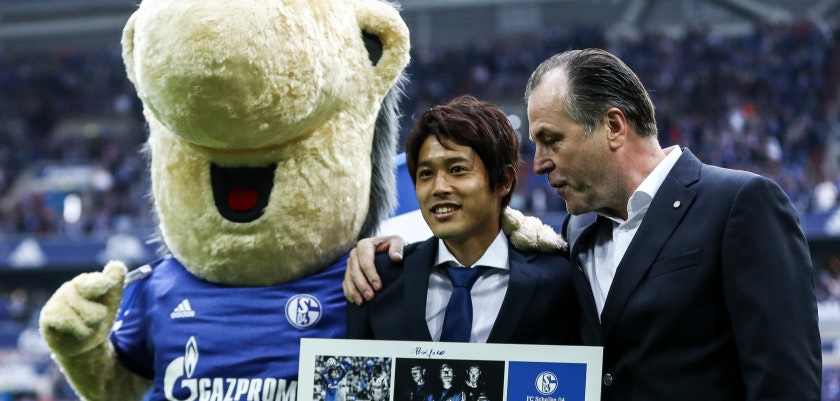 GELSENKIRCHEN, GERMANY - SEPTEMBER 10: Atsuto Uchida of Japan and Clemens Toennies (R) during goodbye ceremony prior the Bundesliga match between FC Schalke 04 and VfB Stuttgart at Veltins-Arena on September 10, 2017 in Gelsenkirchen, Germany. (Photo by Maja Hitij/Bongarts/Getty Images)