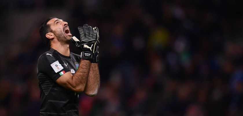 TOPSHOT - Italy's goalkeeper Gianluigi Buffon reacts during the FIFA World Cup 2018 qualification football match between Italy and Sweden, on November 13, 2017 at the San Siro stadium in Milan. / AFP PHOTO / Marco BERTORELLO        (Photo credit should read MARCO BERTORELLO/AFP/Getty Images)