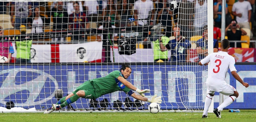 KIEV, UKRAINE - JUNE 24:  Ashley Cole of England has his penalty kick saved by Gianluigi Buffon of Italy during the UEFA EURO 2012 quarter final match between England and Italy at The Olympic Stadium on June 24, 2012 in Kiev, Ukraine.  (Photo by Alex Livesey/Getty Images)