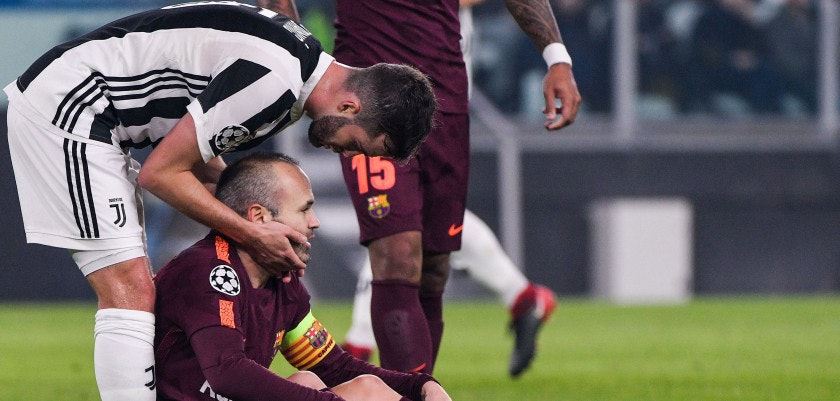 Juventus midfielder Miralem Pjanic (L) speaks to Barcelona's Spanish midfielder Andres Iniesta during the UEFA Champions League Group D football match Juventus Barcelona on November 22, 2017 at the Juventus stadium in Turin.  / AFP PHOTO / Federico TARDITO        (Photo credit should read FEDERICO TARDITO/AFP/Getty Images)