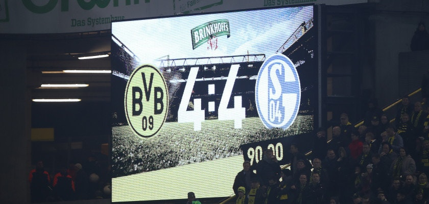 DORTMUND, GERMANY - NOVEMBER 25: The scoreboard displays 4:4 during the Bundesliga match between Borussia Dortmund and FC Schalke 04 at Signal Iduna Park on November 25, 2017 in Dortmund, Germany. (Photo by Alex Grimm/Bongarts/Getty Images)