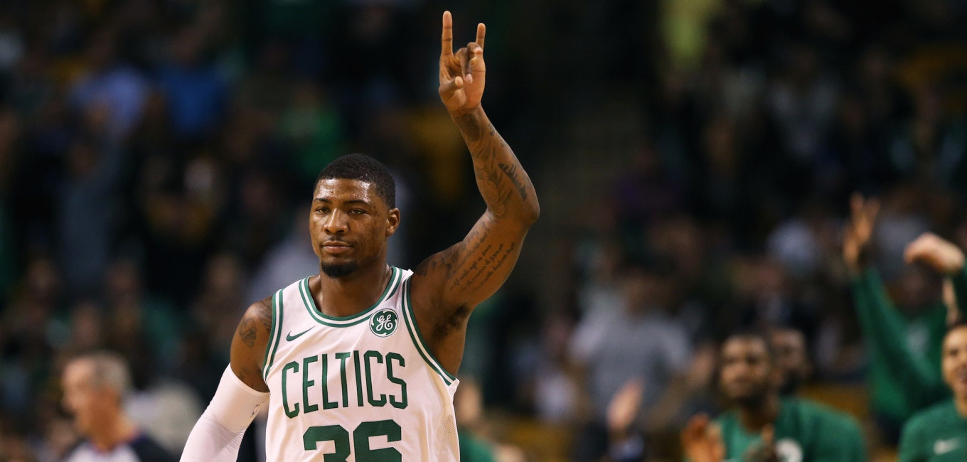 BOSTON, MA - OCTOBER 2: Marcus Smart #36 of the Boston Celtics celebrates after hitting a three point shot against the Charlotte Hornets during the first half at TD Garden on October 2, 2017 in Boston, Massachusetts. NOTE TO USER: User expressly acknowledges and agrees that, by downloading and or using this Photograph, user is consenting to the terms and conditions of the Getty Images License Agreement. (Photo by Maddie Meyer/Getty Images)