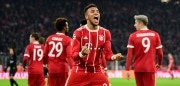 Bayern Munich's French midfielder Corentin Tolisso celebrates after scoring the 3-1 during the UEFA Champions League football match of Bayern Munich vs Paris Saint-Germain on December 5, 2017 in Munich, southern Germany. / AFP PHOTO / Tobias SCHWARZ        (Photo credit should read TOBIAS SCHWARZ/AFP/Getty Images)