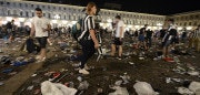 Juventus supporters look for personal belongings at Piazza San Carlo after a panic movement in the fanzone where thousands of Juventus fans were watching the UEFA Champions League Final football match between Juventus and Real Madrid on a giant screen, on June 3, 2017in Turin. / AFP PHOTO / MASSIMO PINCA        (Photo credit should read MASSIMO PINCA/AFP/Getty Images)