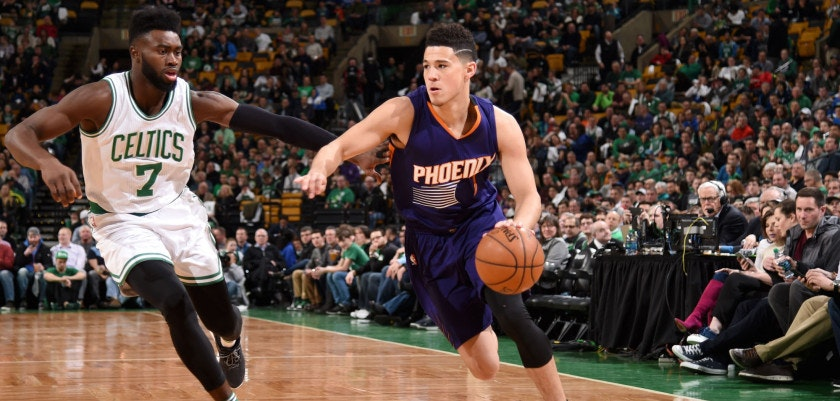 BOSTON, MA - MARCH 24:  Devin Booker #1 of the Phoenix Suns goes to the basket against the Boston Celtics on March 24, 2017 at the TD Garden in Boston, Massachusetts.  NOTE TO USER: User expressly acknowledges and agrees that, by downloading and or using this photograph, User is consenting to the terms and conditions of the Getty Images License Agreement. Mandatory Copyright Notice: Copyright 2017 NBAE  (Photo by Brian Babineau/NBAE via Getty Images)