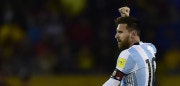 Argentina's Lionel Messi celebrates after scoring his third goal against Ecuador during their 2018 World Cup qualifier football match in Quito, on October 10, 2017. / AFP PHOTO / Rodrigo BUENDIA        (Photo credit should read RODRIGO BUENDIA/AFP/Getty Images)