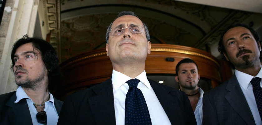 Rome, ITALY:  SS Lazio President Claudio Lotito (C) leaves a hotel in downtown Rome, 22 July 2006, where the four clubs hit by sanctions in the Italian match-fixing trial began their appeals at the federal court. Juventus, Lazio, Fiorentina and AC Milan were all punished for breaking Italian Football Federation (FIGC) rules with the first three relegated to Serie B and the latter given a 15-point penalty for next season.      AFP PHOTO / Andreas SOLARO  (Photo credit should read ANDREAS SOLARO/AFP/Getty Images)