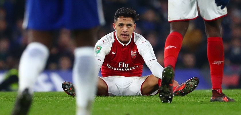 LONDON, ENGLAND - JANUARY 10:  Alexis Sanchez of Arsenal looks dejected during the Carabao Cup Semi-Final First Leg match between Chelsea and Arsenal at Stamford Bridge on January 10, 2018 in London, England.  (Photo by Clive Rose/Getty Images)