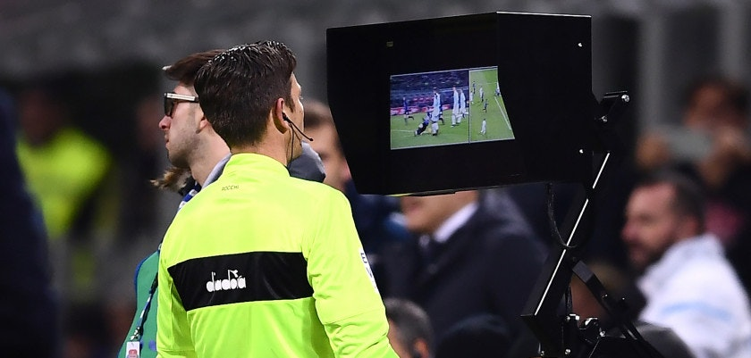 Referee Gianluca Rocchi looks at the screen of the virtual assitance referee (VAR) during the Italian Serie A football match Inter Milan Vs Lazio on December 30, 2017 at the 'San Siro Stadium' in Milan. / AFP PHOTO / MARCO BERTORELLO        (Photo credit should read MARCO BERTORELLO/AFP/Getty Images)