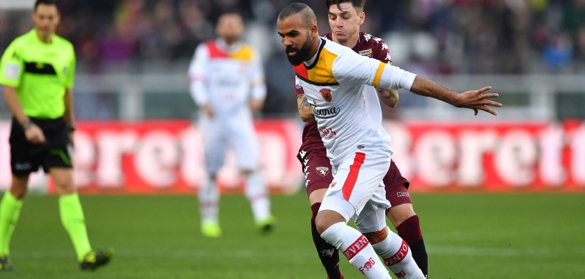 TURIN, ITALY - JANUARY 28: Daniele Baselli (R) of Torino FC competes with Cordeiro Sandro Raniere of Benevento Calcio during the Serie A match between Torino FC and Benevento Calcio at Stadio Olimpico di Torino on January 28, 2018 in Turin, Italy. (Photo by Valerio Pennicino/Getty Images)