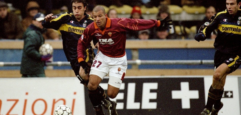 19 Dec 1999:  Fabio Junior of Roma is tackled by Fabio Cannavaro of Parma during the Italian Serie A match played at the Stadio Tardini in Turin, Italy. Parma won the game 2-0.  Mandatory Credit: Claudio Villa /Allsport