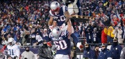 FOXBOROUGH, MA - JANUARY 13:  James White #28 of the New England Patriots reacts with David Andrews #60 after scoring a touchdown in the first quarter of the AFC Divisional Playoff game against the Tennessee Titans at Gillette Stadium on January 13, 2018 in Foxborough, Massachusetts.  (Photo by Jim Rogash/Getty Images)