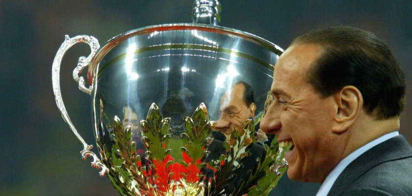 Milan, ITALY:  AC Milan's president Silvio Berlusconi holds the Cup after Berlusconi trophy between Juventus and AC Milan at San Siro Stadium in Milan, 06 January  2006. AC Milan beat Juventus 3-2. AFP PHOTO / GIUSEPPE CACACE  (Photo credit should read GIUSEPPE CACACE/AFP/Getty Images)