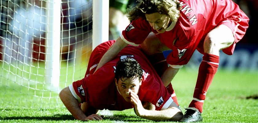 3 Apr 1999:  Robbie Fowler of Liverpool is pulled away by team mate Steve McManaman after mimicking cocaine snorting to celebrate his first goal against Everton in the FA Carling Premiership match at Anfield in Liverpool, England. Liverpool won 3-2.  Mandatory Credit: Ross Kinnaird /Allsport