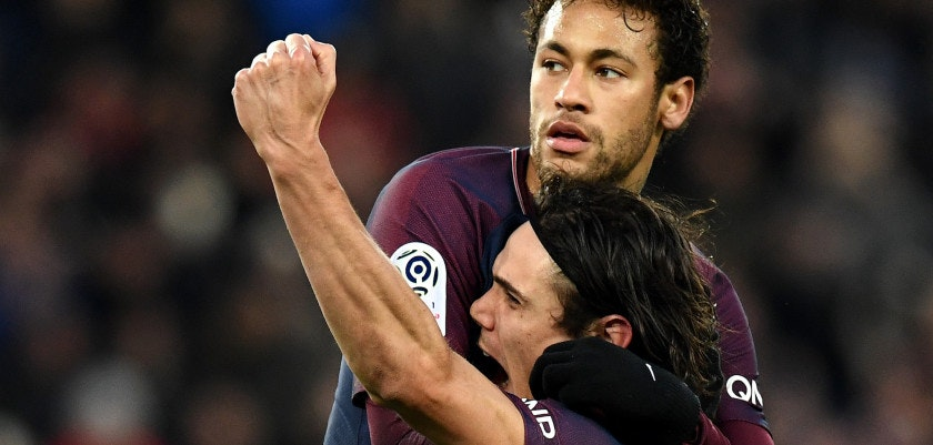 Paris Saint-Germain's Brazilian forward Neymar (L) is congratuled by Paris Saint-Germain's Uruguayan forward Edinson Cavani after scoring a penalty kick  during the French L1 football match between Paris Saint-Germain (PSG) and Montpellier (MHSC) at the Parc des Princes stadium in Paris on January 27, 2018. / AFP PHOTO / FRANCK FIFE        (Photo credit should read FRANCK FIFE/AFP/Getty Images)