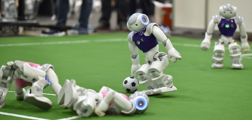 Robots fight for the ball during their football match in the standard platform league tournament at the RoboCup 2017 in Nagoya, Aichi prefecture on July 30, 2017.   In the four-day RoboCup 2017, about 3,000 researchers and engineering students showed off their latest technologies, with robot footballers competing in eight leagues. / AFP PHOTO / Kazuhiro NOGI        (Photo credit should read KAZUHIRO NOGI/AFP/Getty Images)