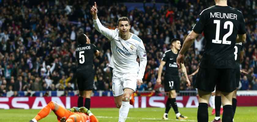 MADRID, SPAIN - FEBRUARY 14:  Cristiano Ronaldo of Real Madrid celebrates scoring the 2nd Real Madrid goal during the UEFA Champions League Round of 16 First Leg match between Real Madrid and Paris Saint-Germain at Bernabeu on February 14, 2018 in Madrid, Spain.  (Photo by Gonzalo Arroyo Moreno/Getty Images)