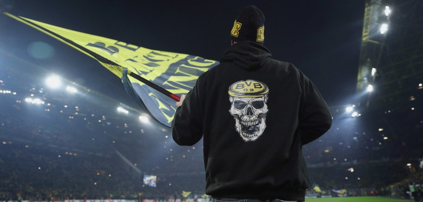 DORTMUND, GERMANY - FEBRUARY 15:  A fan of Dortmund waves a flag prior to UEFA Europa League Round of 32 match between Borussia Dortmund and Atalanta Bergamo at the Signal Iduna Park on February 15, 2018 in Dortmund, Germany.  (Photo by Alex Grimm/Bongarts/Getty Images)